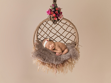 Newborn Baby girl in hanging floral basket
