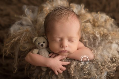 Baby newborn with bear