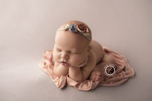 Froggy newborn girl pose